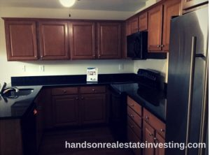 Eat-In Kitchen w/ Granite Countertops beginner real estate investor how to invest in real estate