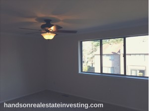 Master Bedroom w/ Ceiling Fan beginner real estate investor how to invest in real estate